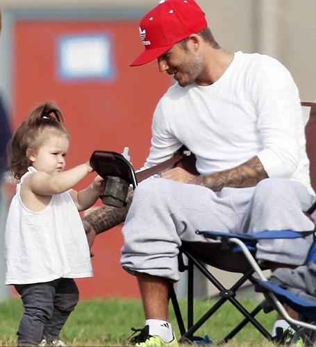 Harper Beckham wears jeans for dads football game