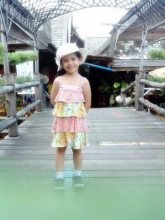 fashion girl little model wearing tiered print dress