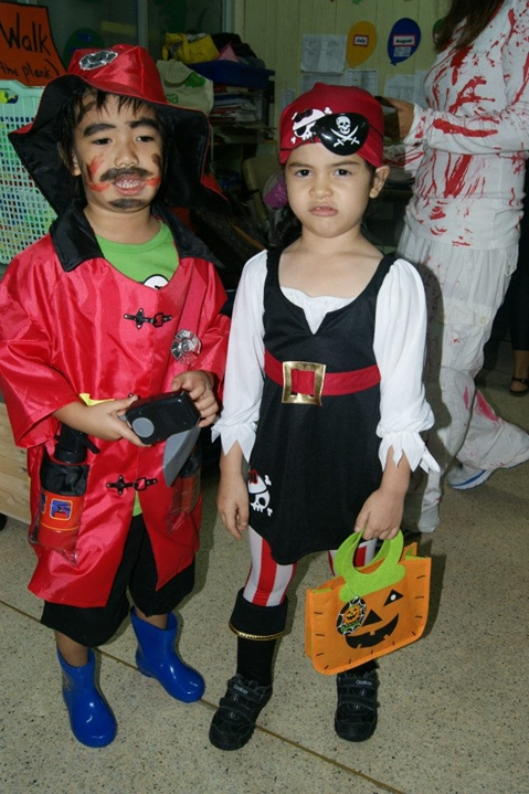 Halloween costumes kids fireman and pirate