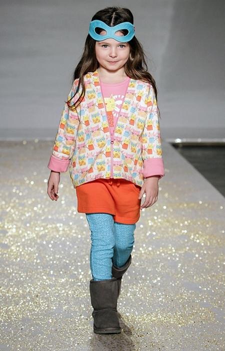 runway little girl model wearing ugg boots