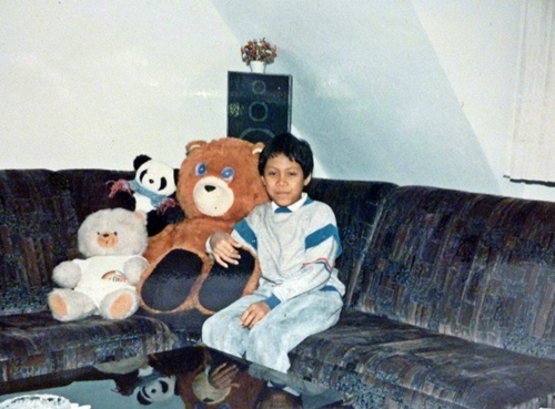 a boy with his old teddy bear